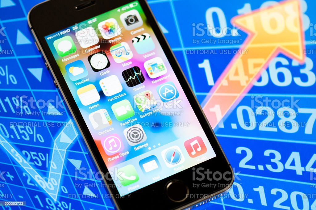 iPhone 5s in front of stock charts royalty-free stock photo
