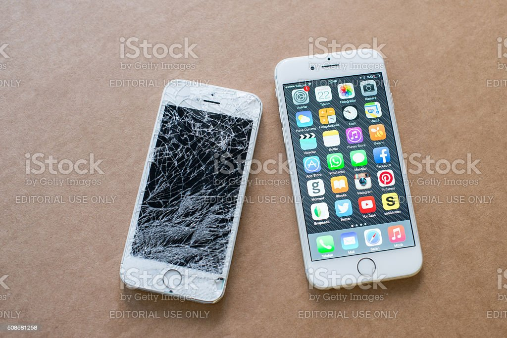 iPhone 6 and broken iPhone 5s stock photo