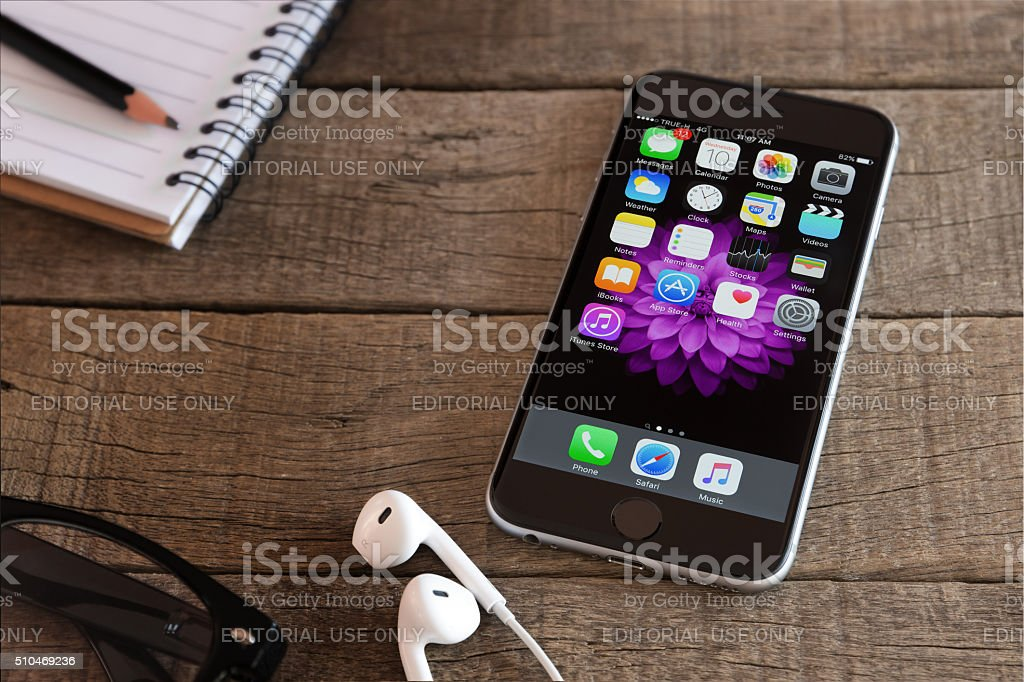 Iphone 6 and ios application on wood desk stock photo