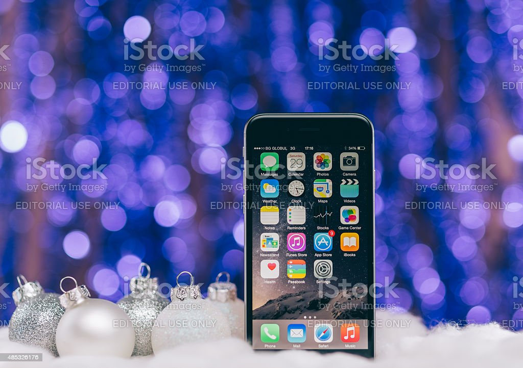 iPhone 6 at Christmas bokeh background stock photo