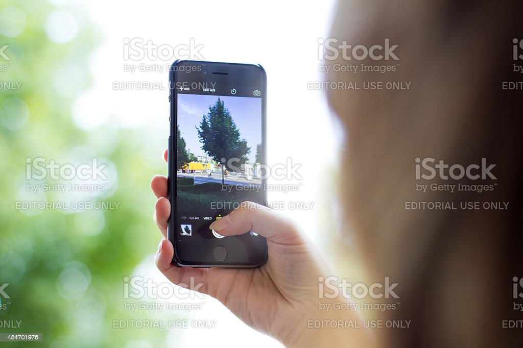 iPhone 6 in womans hand stock photo