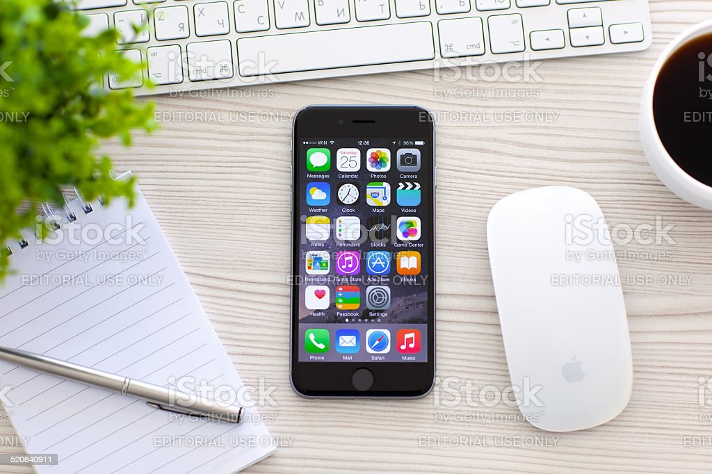 iPhone 6 Space Gray with apps on screen stock photo