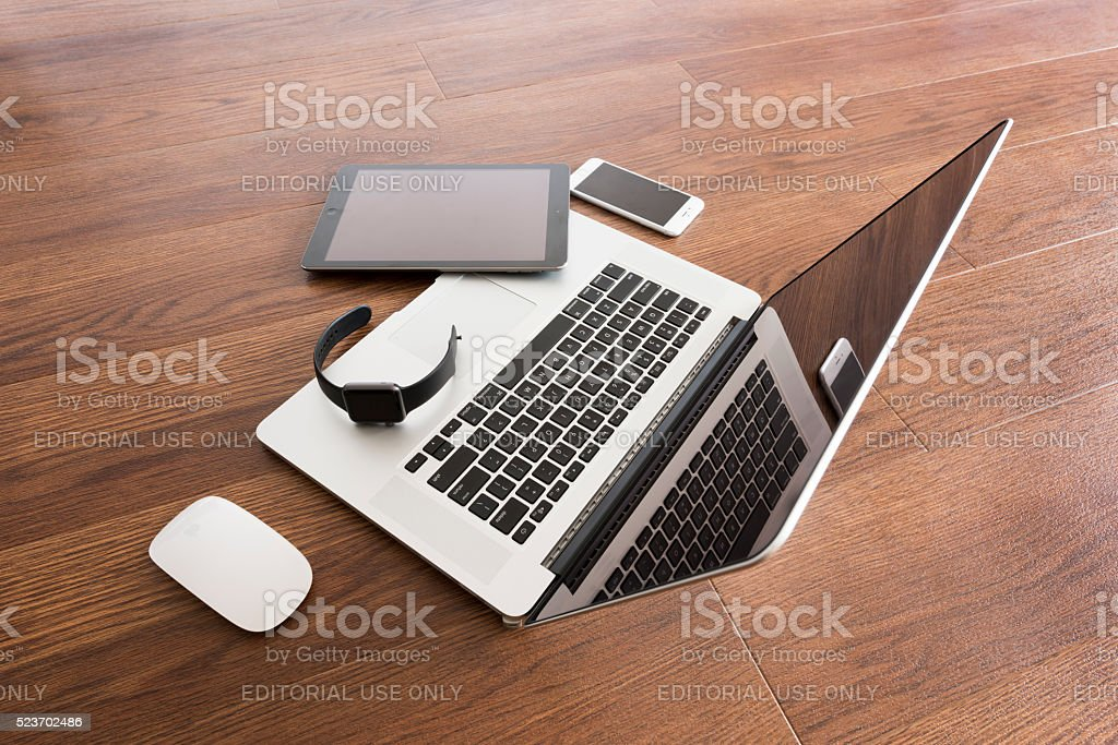 iPhone 6s placed next to MacBook Pro 15inch stock photo