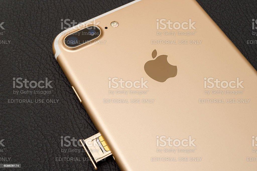 iPhone 7 plus dual camera unboxing inser SIM CARD module stock photo