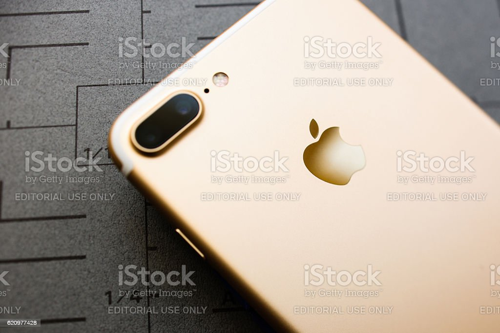 iPhone 7 Plus rose gold on gray background stock photo
