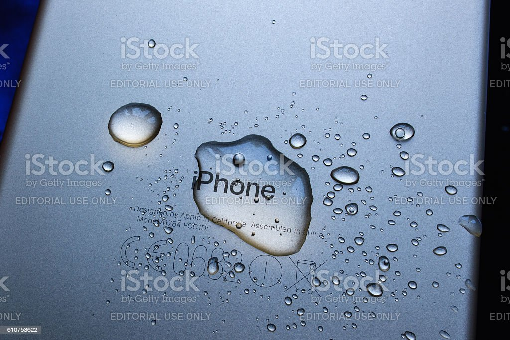 iPhone 7 Plus waterproof iPhone logo covered with water stock photo