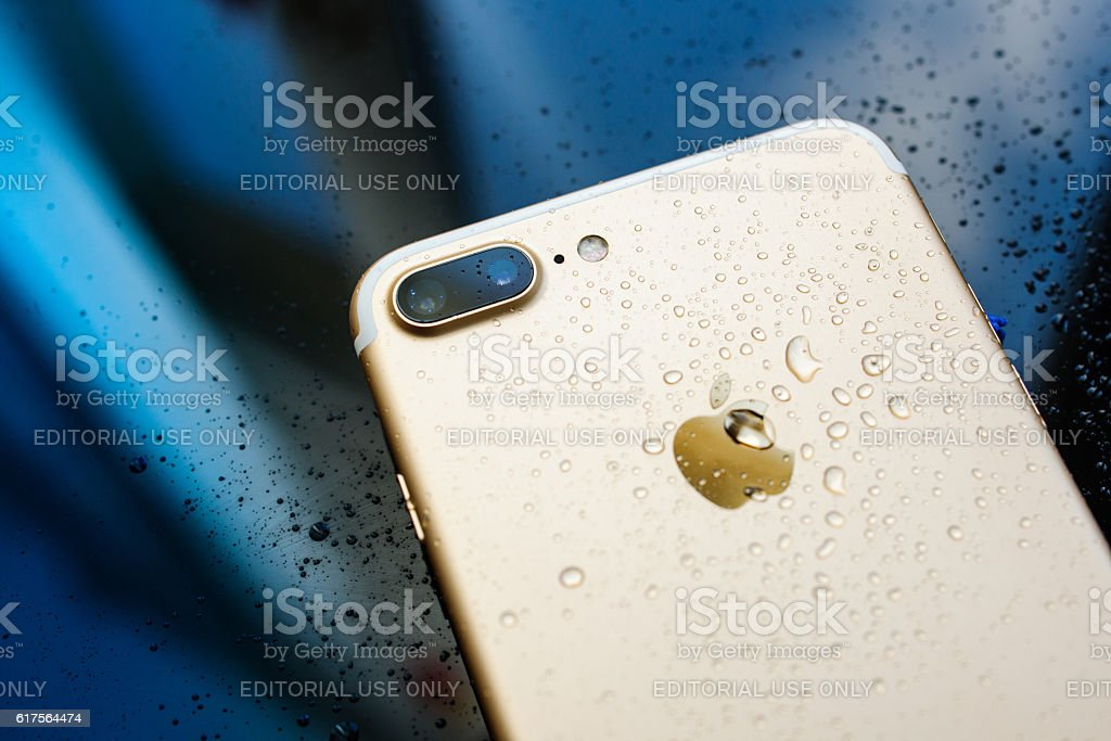iPhone 7 Plus waterproof with rain drops on rear glass stock photo