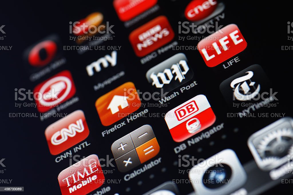 Iphone display with collection of apps stock photo