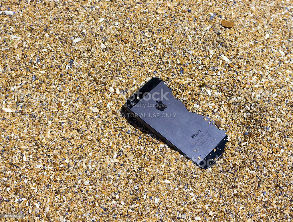 iPhone in a sand stock photo