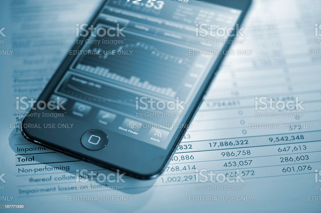 iphone on financial report royalty-free stock photo