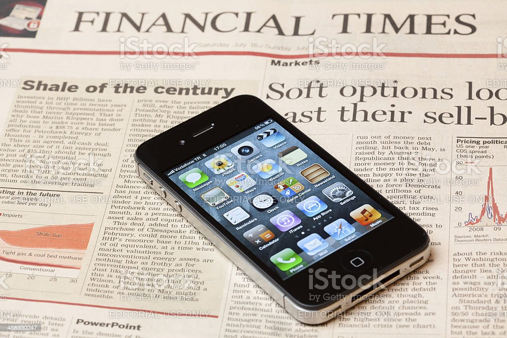 Iphone on Financial Times newspaper stock photo