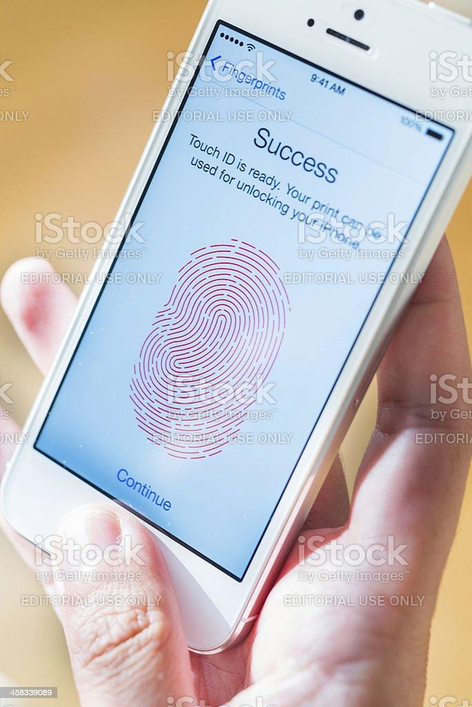 iphone with fingerprint identity future royalty-free stock photo