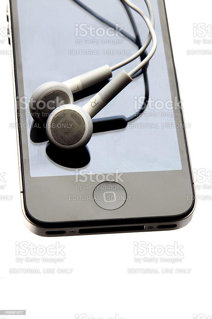 iphone with headphones royalty-free stock photo