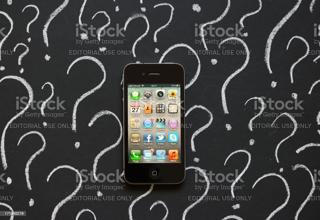 iPhone with question marks royalty-free stock photo