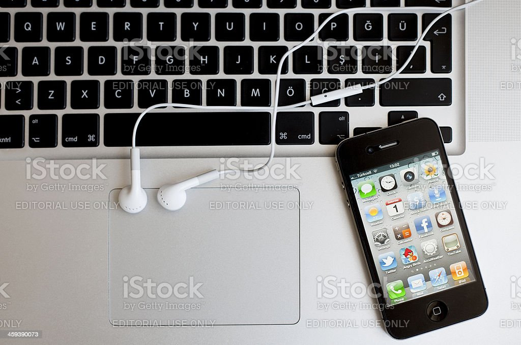 iPhone4 on laptop royalty-free stock photo