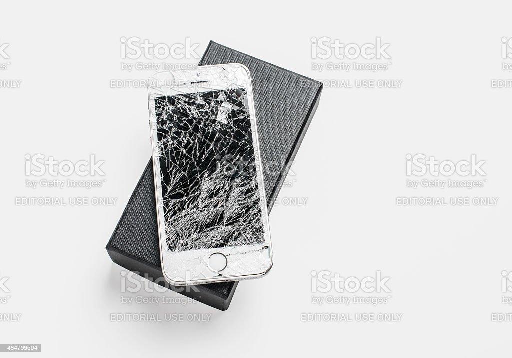 iPone 5s with broken screen stock photo