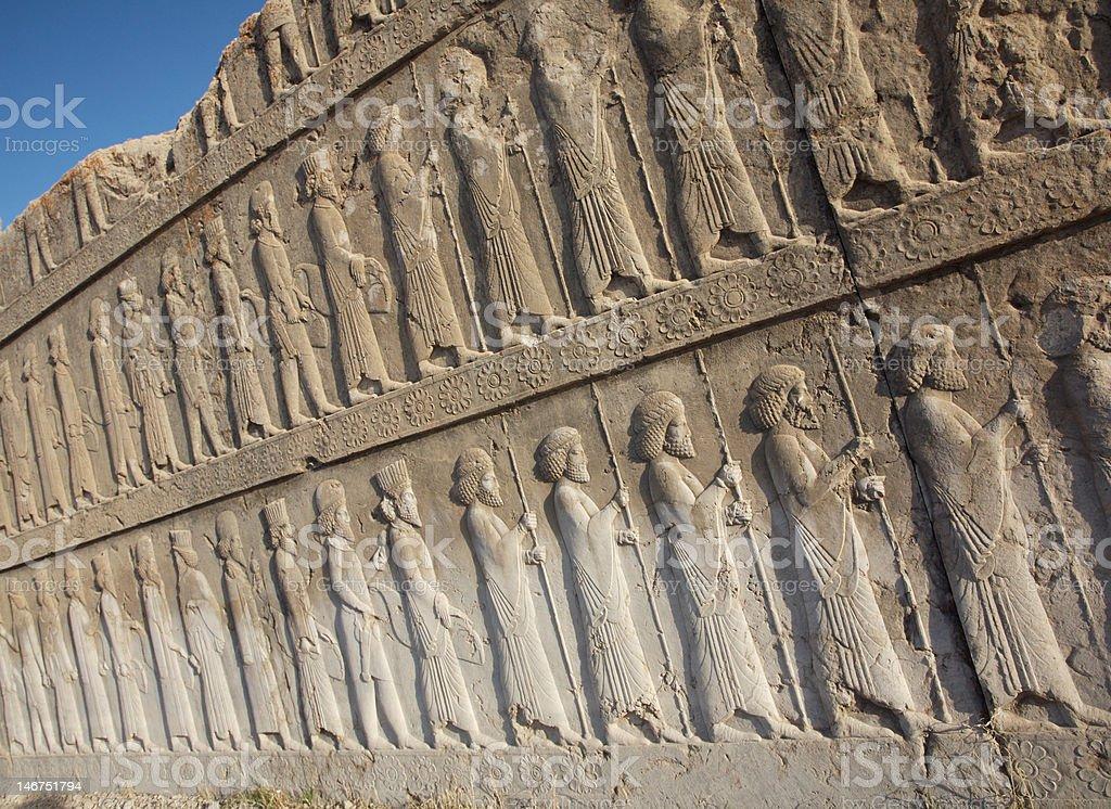 Iran. Relief of ancient persian warriors at persepolis near Shiraz stock photo