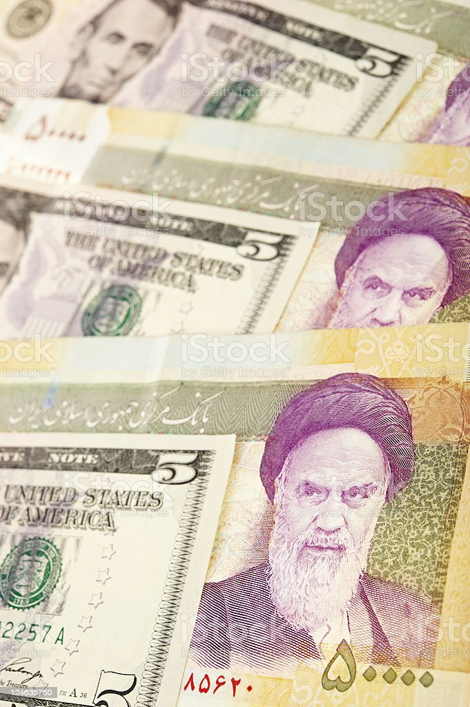 Iranian and American banknotes stock photo