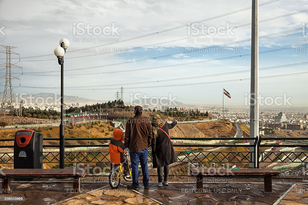Iranian Family Staring at Skyline of Tehran from a Park stock photo