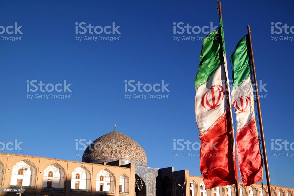 Iranian flags in front of Sheikh Lotfollah Mosque, Esfahan stock photo