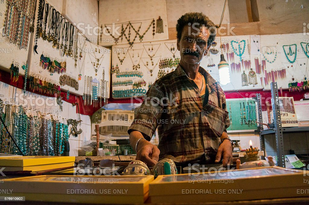 Iranian handicraft maker inside his shop stock photo