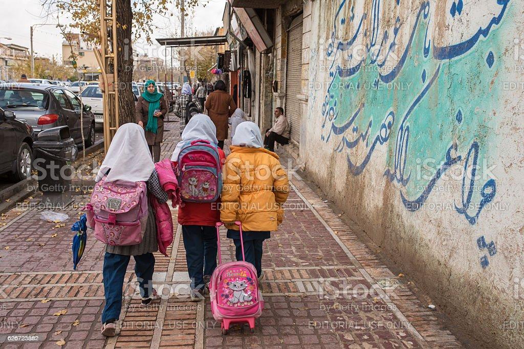 Iranian schoolgirls walk on the streets of Shiraz city, Iran stock photo