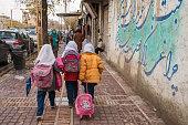 Iranian schoolgirls walk on the streets of Shiraz city, Iran
