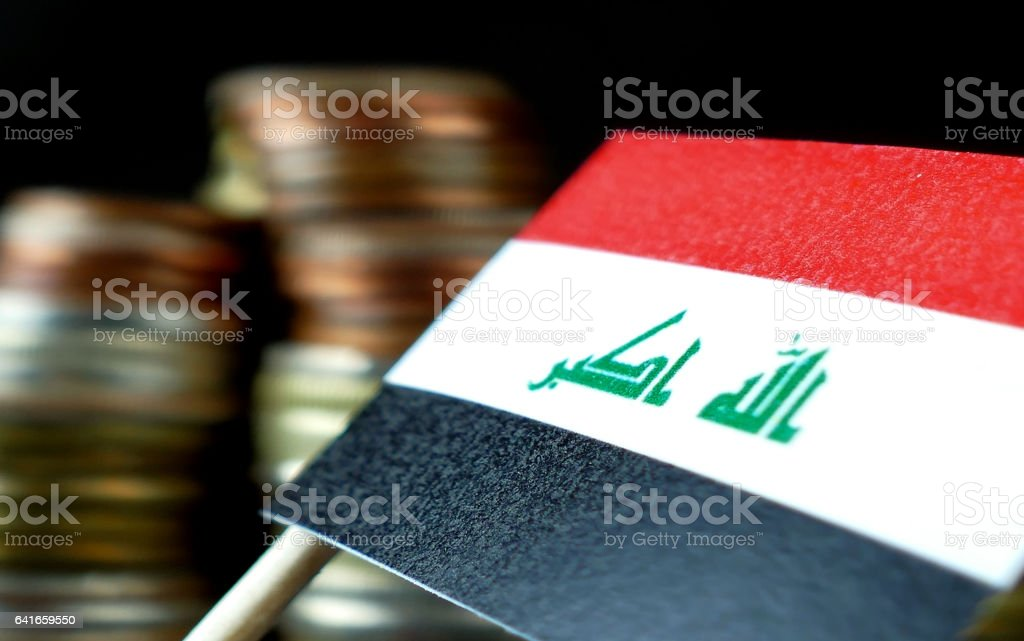 Iraq flag waving with stack of money coins macro stock photo