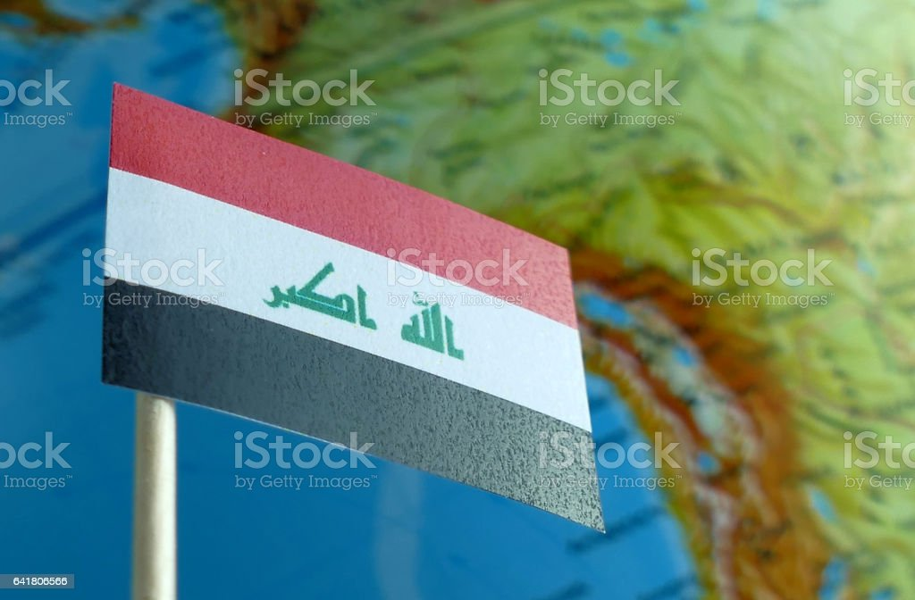 Iraq flag with a globe map as a background macro stock photo