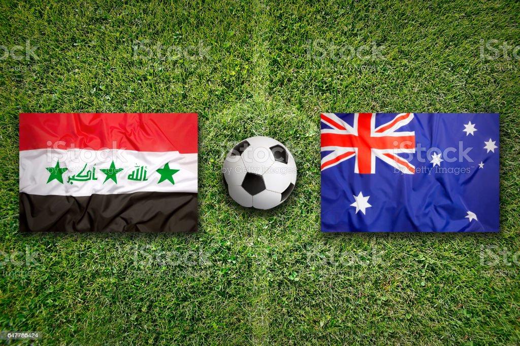 Iraq vs. Australia flags on soccer field stock photo