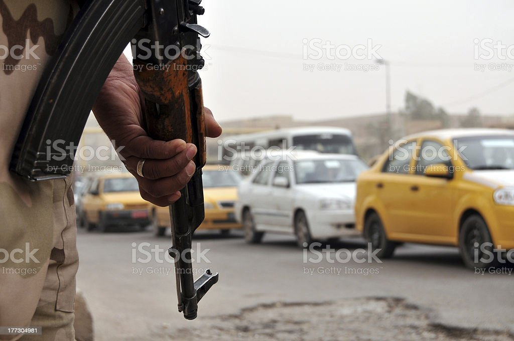 Iraqi soldier at roadblock stock photo