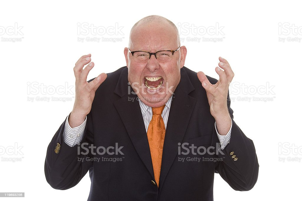 Irate businessman waving his arms and screaming at camera stock photo