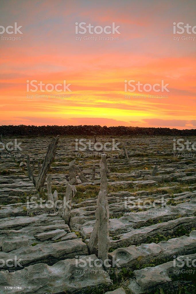 Ireland: Sunset, Karst Plains of Inis Mor, Aran Islands royalty-free stock photo