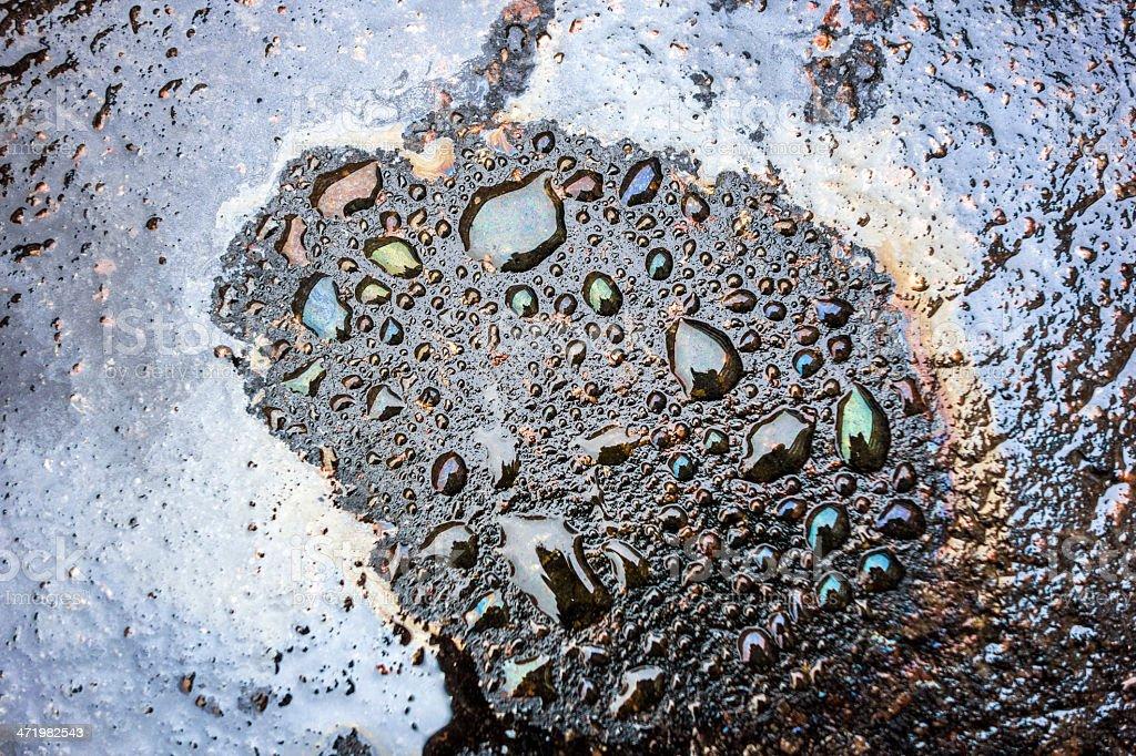 Iridescence of oil on asphalt surface. royalty-free stock photo