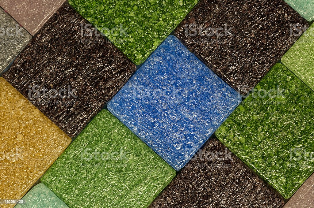 Iridescent Blue, Green and Yellow Tile Pattern Close-Up royalty-free stock photo