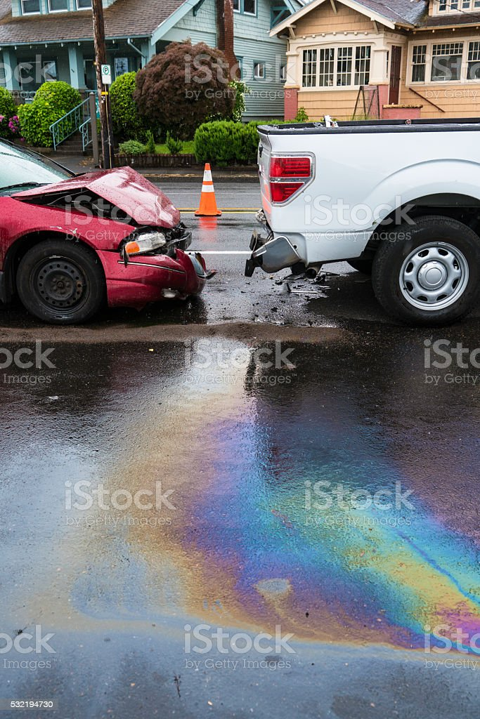 Iridescent oil spill caused by a traffic accident stock photo