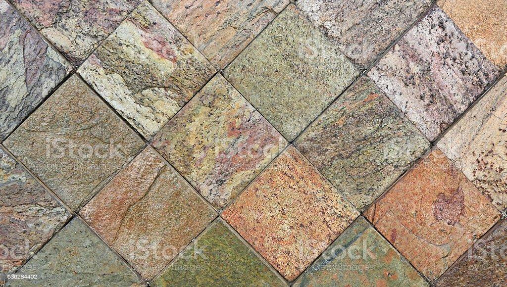 Iridescent stone brick wall texture background stock photo