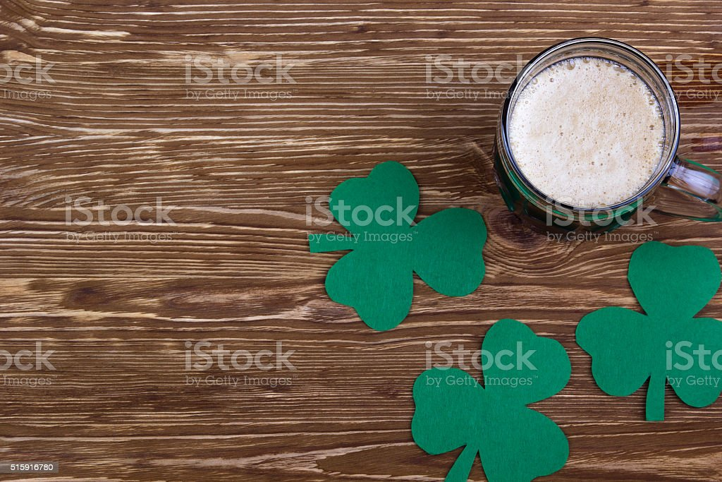 Irish beer for St Patick's Day and clover leaves stock photo