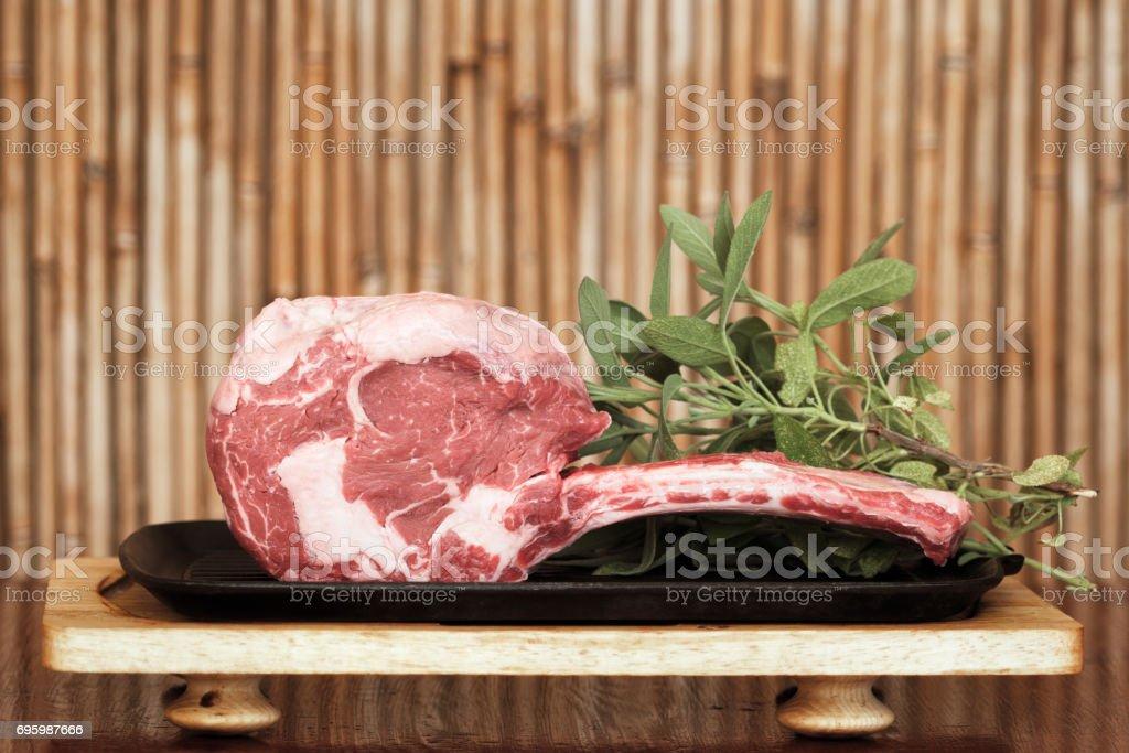 Irish Black Angus Tomahawk steak, with sage leaves stock photo