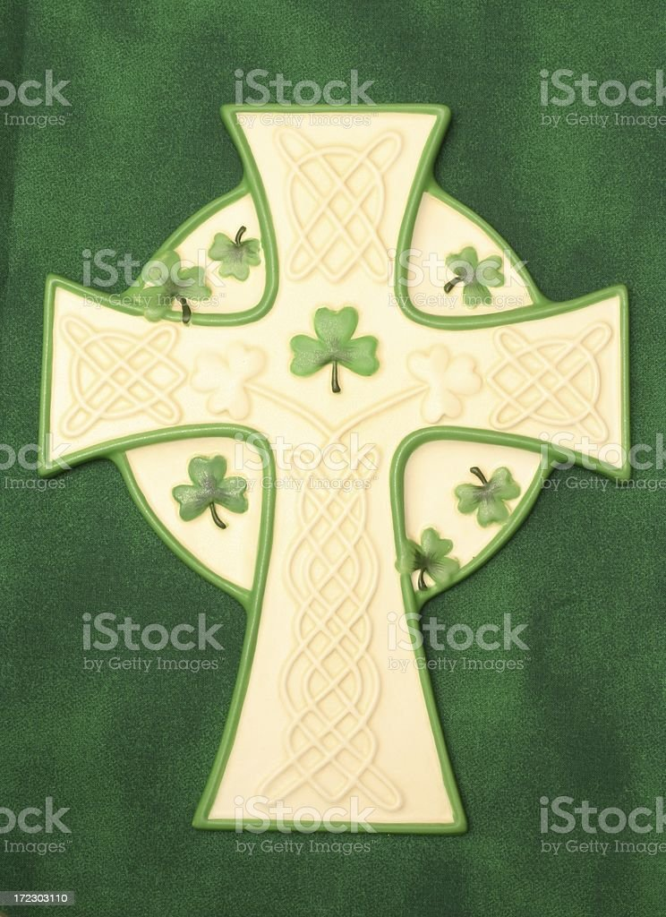 Irish Celtic Cross on green background stock photo
