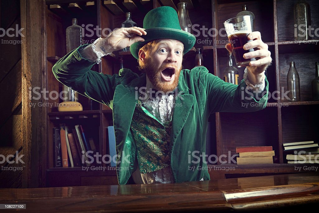 Irish Character / Leprechaun Celebrating with Pint of Beer stock photo