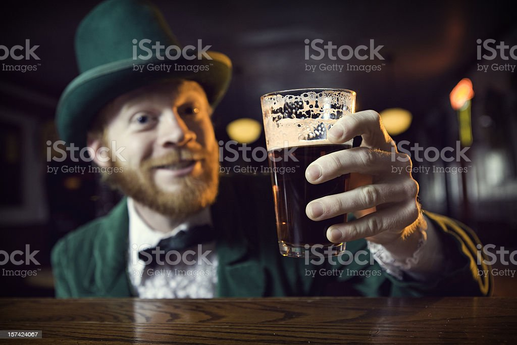 Irish Character / Leprechaun Making a Toast with Beer stock photo