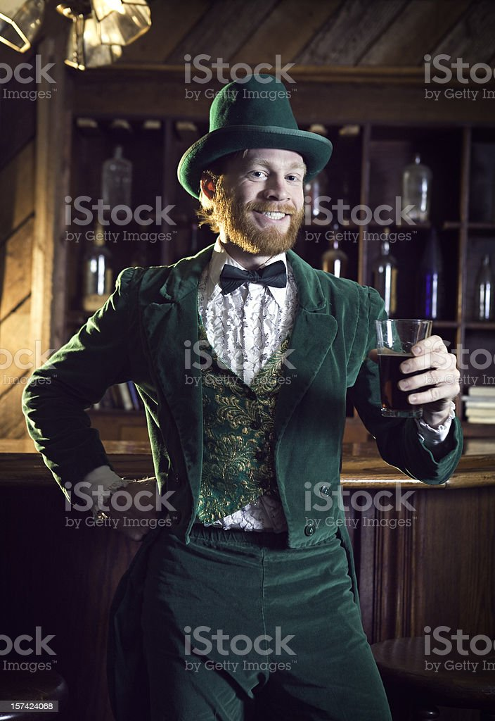 Irish Character / Leprechaun Making a Toast with Beer royalty-free stock photo