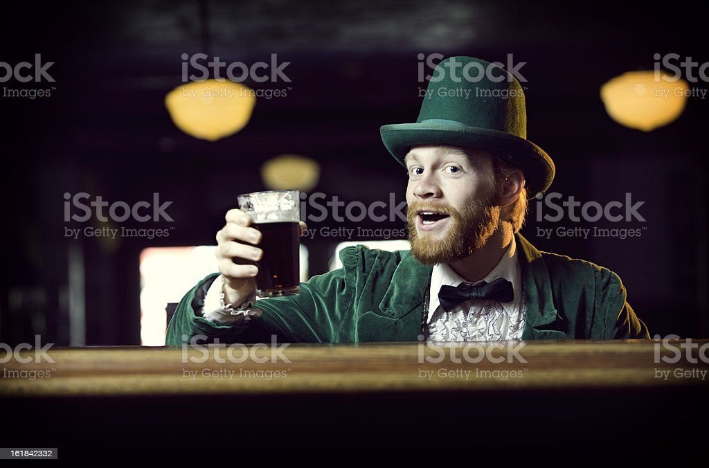 Irish Character / Leprechaun Toasting with a Pint of Beer stock photo