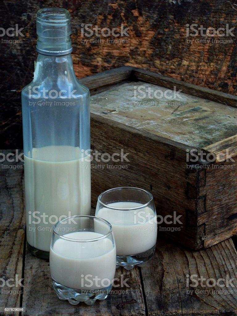 Irish coffee cream liqueur Baileys in glass and botle stock photo