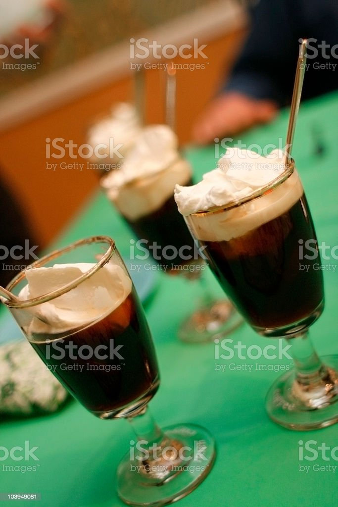 Irish Coffees With Whipped Cream - On Green Tablecloth royalty-free stock photo