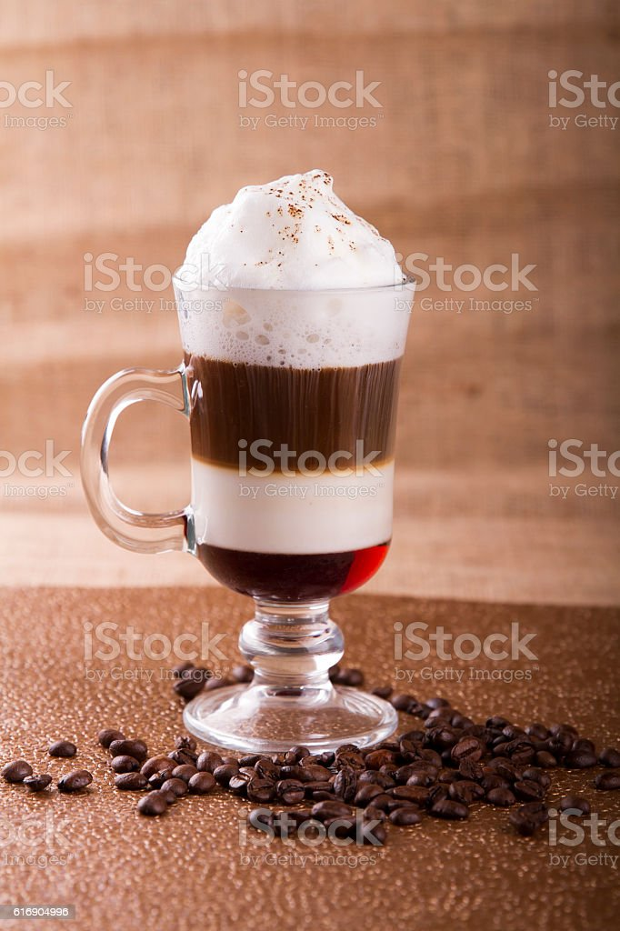 Irish cream coffee decorated with coffee beans on the table stock photo