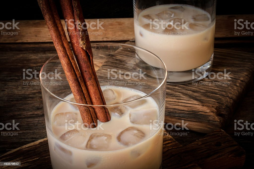 Irish cream liqueur in a glass with ice and cinnamon stock photo