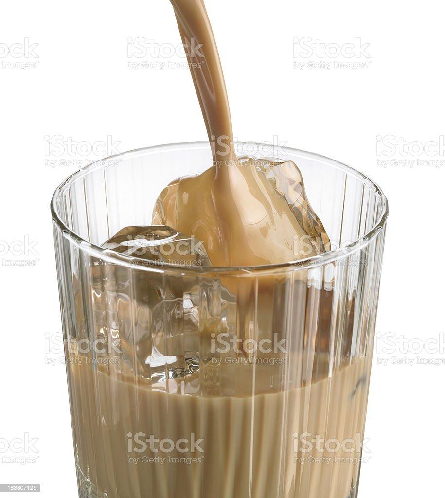 Irish cream liqueur pouring into crystal glass stock photo