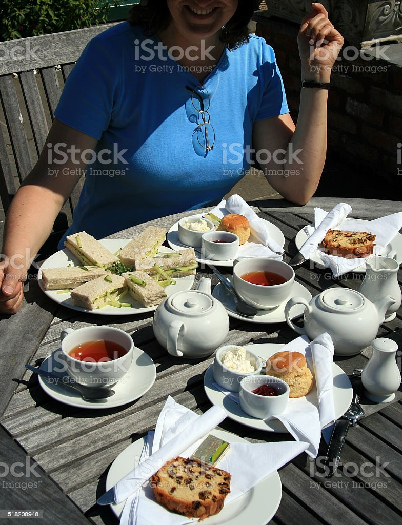 Irish Cream Tea with sandwiches and scones stock photo